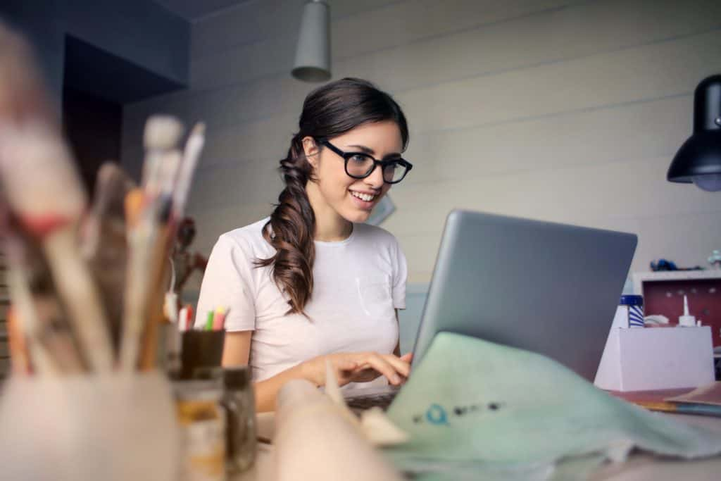 bookkeeper woman working from home on laptop