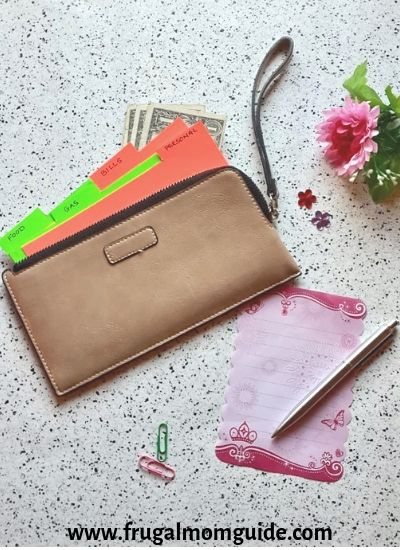 best cash envelope wallets - cash envelope templates in wristlet flat lay
