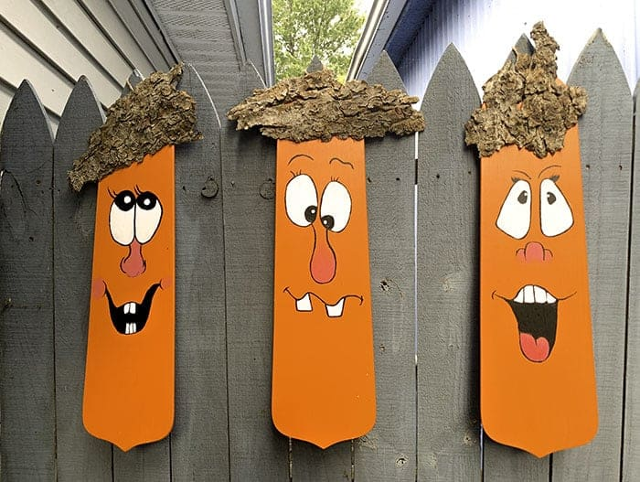 fall decor diy - three planks painted orange with faces
