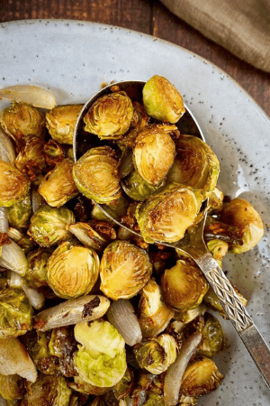 roasted brussels sprouts on spoon and in dish