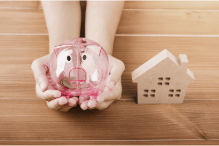 piggy bank and house on table